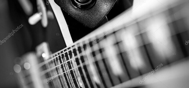 depositphotos_40028219-stock-photo-electric-guitar-macro-abstract-black
